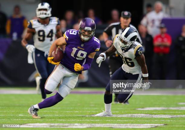 Adam Thielen of the Minnesota Vikings runs with the ball and evades defender Dominique Hatfield of the Los Angeles Rams of the game on November 19...
