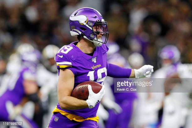 Adam Thielen of the Minnesota Vikings runs with the ball during the first half against the New Orleans Saints in the NFC Wild Card Playoff game at...