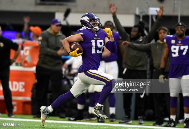 Adam Thielen of the Minnesota Vikings runs with the ball for a 65 yard touchdown in the fourth quarter of the game against the Los Angeles Rams on...