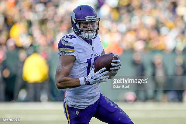 Adam Thielen of the Minnesota Vikings runs with the ball in the first quarter against the Green Bay Packers at Lambeau Field on December 24 2016 in...