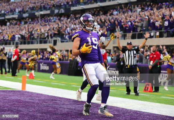 Adam Thielen of the Minnesota Vikings runs with the ball into the end zone for a 65 yard touchdown in the fourth quarter of the game against the Los...