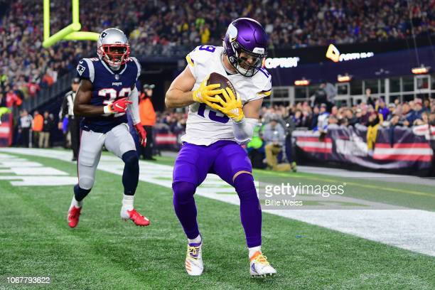 Adam Thielen of the Minnesota Vikings scores a touchdown during the second quarter against the New England Patriots at Gillette Stadium on December 2...
