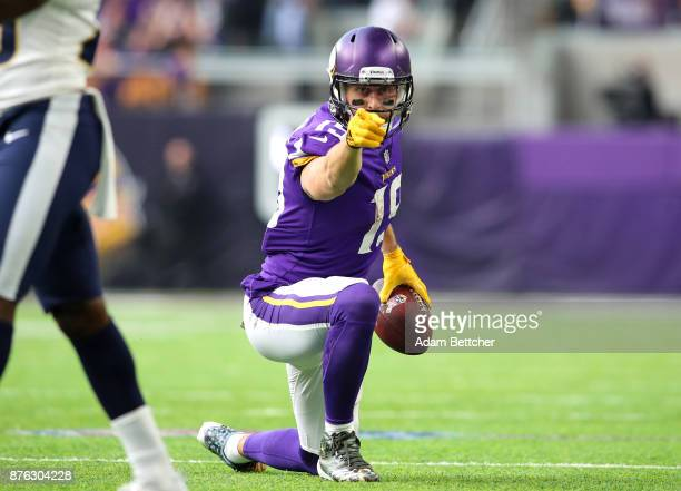 Adam Thielen of the Minnesota Vikings signals a first down after catching the ball in the first half of the game against the Los Angeles Rams on...