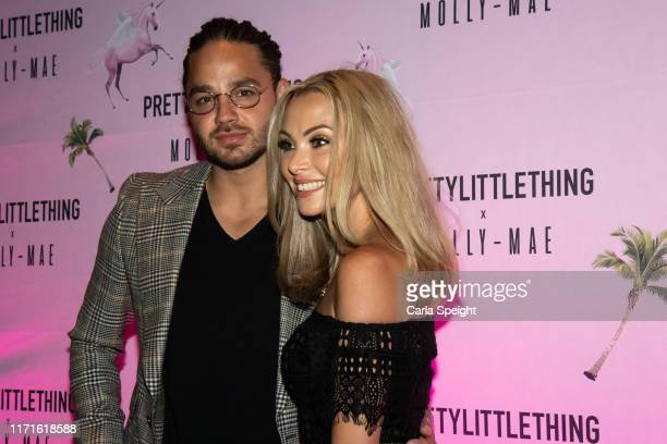 Adam Thomas and Caroline Daly attend the Pretty Little Thing X MollyMae party at Rosso on September 01 2019 in Manchester England