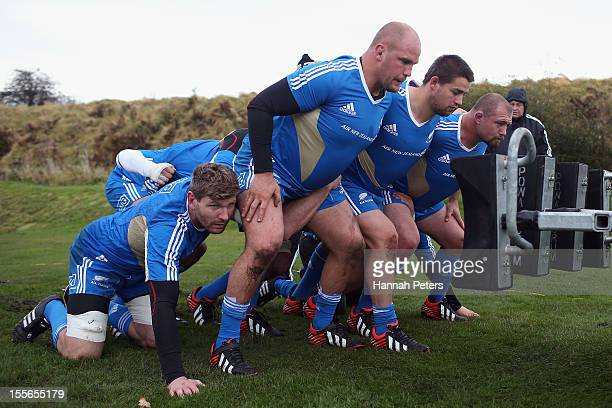 Adam Thompson Ben Franks Dane Coles and Tony Woodcock of the All Blacks run through scrum drills during a training session at Peffermill University...