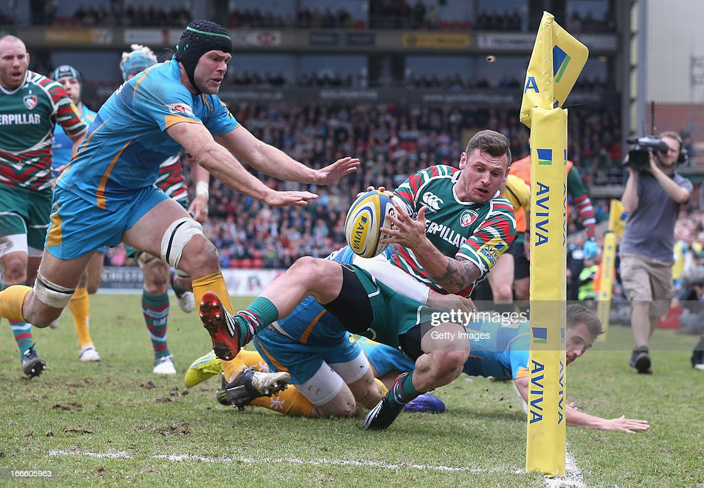 Adam Thompstone of Leicester is tackled into touch just short of the try line during the Aviva Premiership match between Leicester Tigers and London Wasps at Welford Road on April 14, 2013 in Leicester, England.