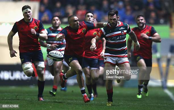 Adam Thompstone of Leicester kicks the ball upfield as Simon Zebo tackles during the European Rugby Champions Cup match between Leicester Tigers and...