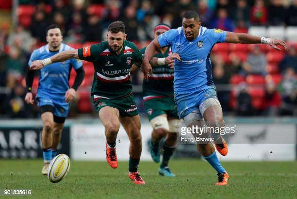 Adam Thompstone of Leicester Tigers and Joe Cokanasiga of London Irish compete for the loose ball during the Aviva Premiership match between...