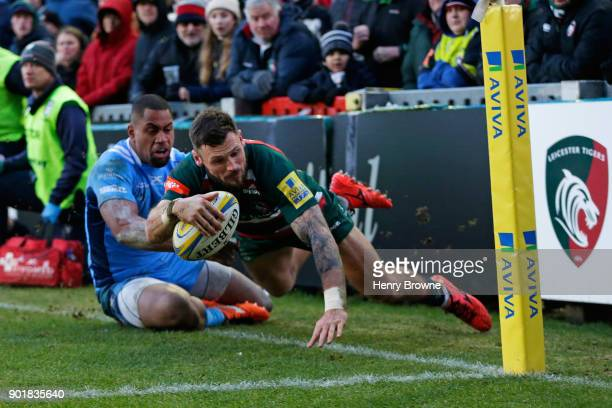 Adam Thompstone of Leicester Tigers and Joe Cokanasiga of London Irish during the Aviva Premiership match between Leicester Tigers and London Irish...