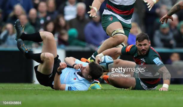 Adam Thompstone of Leicester Tigers collides with the referee Craig MaxwellKeys during the Gallagher Premiership Rugby match between Leicester Tigers...