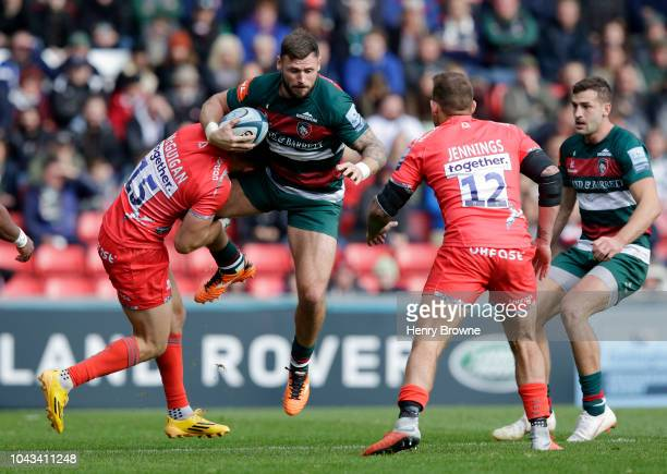 Adam Thompstone of Leicester Tigers is tackled by Byron McGuigan of Sale Sharks during the Gallagher Premiership Rugby match between Leicester Tigers...