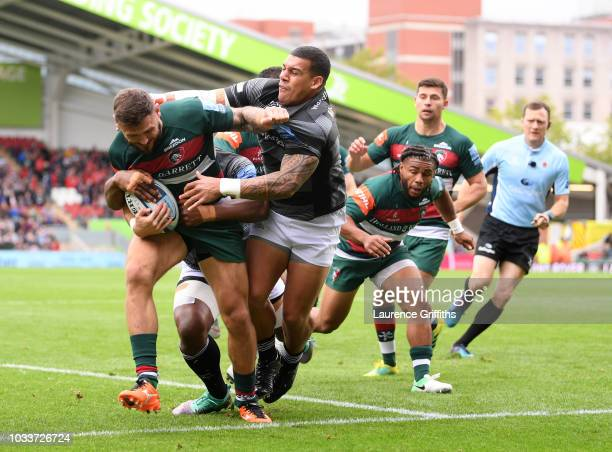 Adam Thompstone of Leicester Tigers is tackled by Josh Matavesi of Newcastle Falcons during the Gallagher Premiership Rugby match between Leicester...