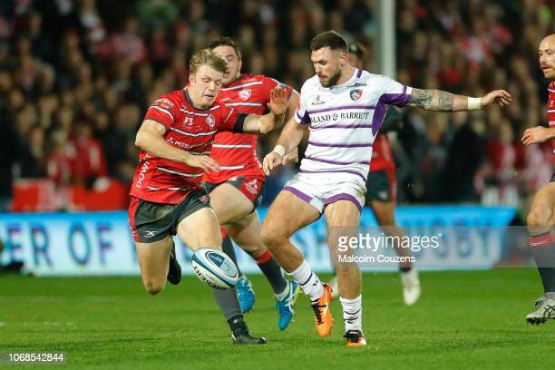 Adam Thompstone of Leicester Tigers kicks the ball ahead of Ollie Thornley of Gloucester Rugby during the Gallagher Premiership Rugby match between...