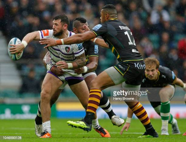 Adam Thompstone of Leicester Tigers tackled by Luther Burrell and Taqele Naiyaravoro of Northampton Saints during the Gallagher Premiership Rugby...