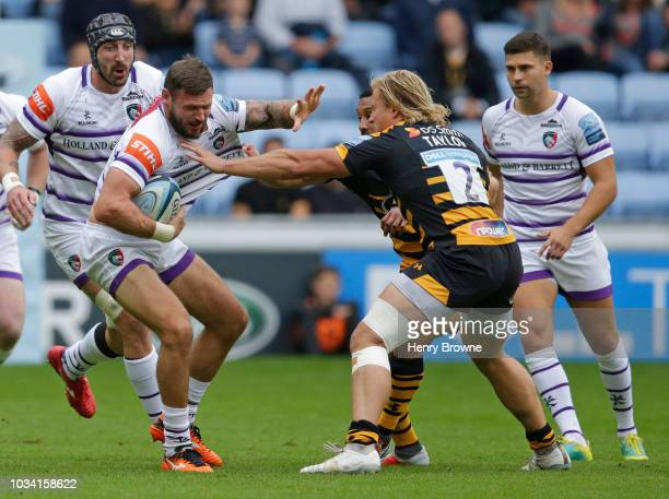 Adam Thompstone of Leicester Tigers tackled by Tommy Taylor of Wasps during the Gallagher Premiership Rugby match between Wasps and Leicester Tigers...