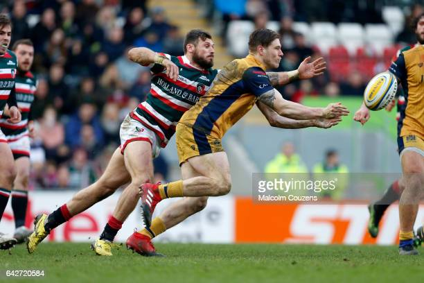 Adam Thompstone of Leicester Tigers tackles Jason Woodward of Bristol Rugby during the Aviva Premiership match between Leicester Tigers and Bristol...