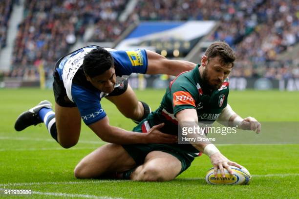 Adam Thompstone of Leicester Tigers touches down for the first try past Ben Tapuai of Bath Rugby during the Aviva Premiership match between Bath...