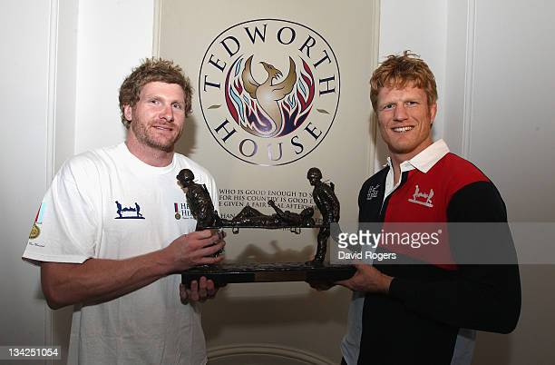 Adam Thomson captain of the Southern Hemisphere team and Hugh Vyvyan captain of the Northern Hemisphere team hold the Help for Heroes Challenge...