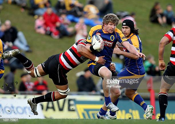Adam Thomson of Otago is tackled by Taiasina Tuifua of Counties Manukau during the round one ITM Cup match between Counties Manukau and Otago at...