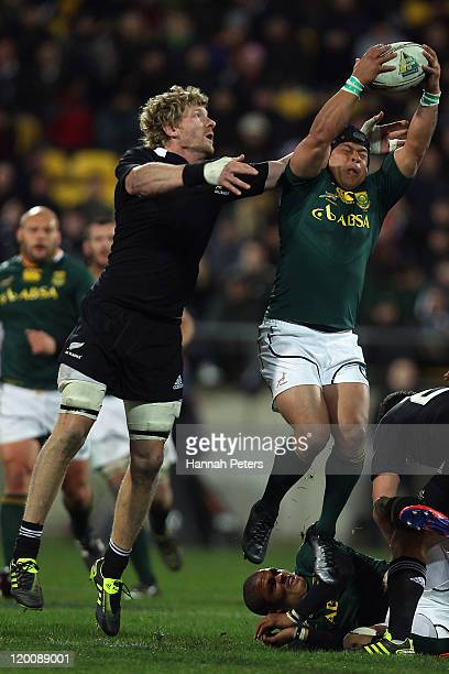 Adam Thomson of the All Blacks competes with Adrian Jacobs of South Africa during the TriNations match between the New Zealand All Blacks and the...
