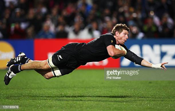 Adam Thomson of the All Blacks goes over to score his try during the IRB 2011 Rugby World Cup Pool A match between New Zealand and Japan at Waikato...