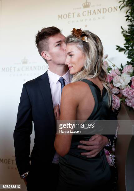 Adam Tomlinson and Amy Pejkovic attend Moet Chandon Spring Champion Stakes Day at Royal Randwick Racecourse on October 7 2017 in Sydney Australia