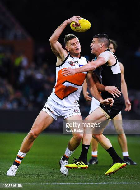 Adam Tomlinson of the Giants competes with Tom Rockliff of Port Adelaide during the round 18 AFL match between the Port Adelaide Power and the...