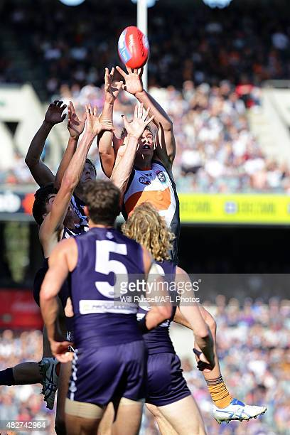 Adam Tomlinson of the Giants goes for the mark during the round 18 AFL match between the Fremantle Dockers and the Greater Western Sydney Giants at...