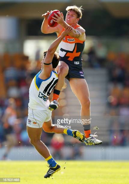 Adam Tomlinson of the Giants marks over Dion Prestia of the Suns during the round five AFL match between the Greater Western Sydney Giants and the...