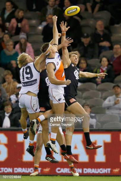 Adam Tomlinson of the Giants spoils Patrick Cripps of the Blues during the round 20 AFL match between the Carlton Blues and the Greater Western...