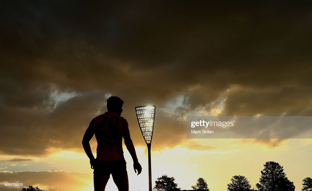 Adam Tomlinson of the Giants watches on as the sun sets during the JLT Community Series AFL match between the Greater Western Sydney Giants and the Collingwood Magpies at UNSW Canberra Oval on March 1, 2018 in Canberra, Australia.