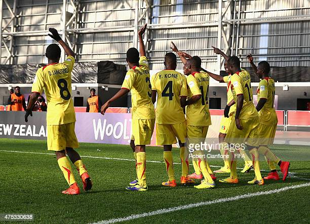 Adam Traore of Mali celebrates with team mates after scoring a goal during the FIFA U20 World Cup New Zealand 2015 Group D match between Mexico and...