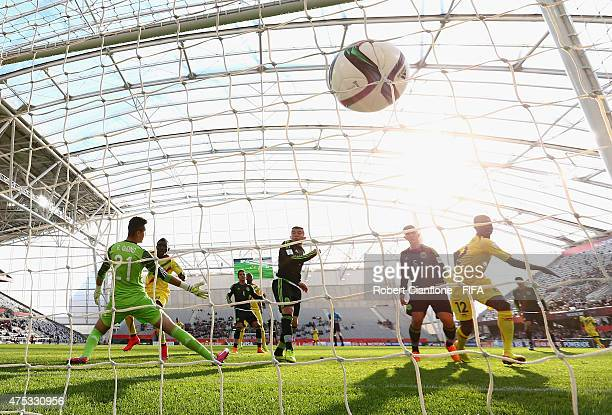 Adam Traore of Mali shoots past Mexican goalkeeper Raul Gudino to score during the FIFA U20 World Cup New Zealand 2015 Group D match between Mexico...