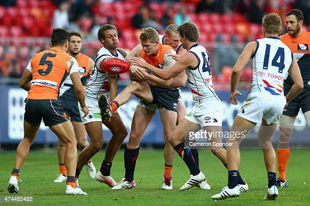 Adam Treloar of the Giants is tackled during the round eight AFL match between the Greater Western Sydney Giants and the Adelaide Crows at Spotless...