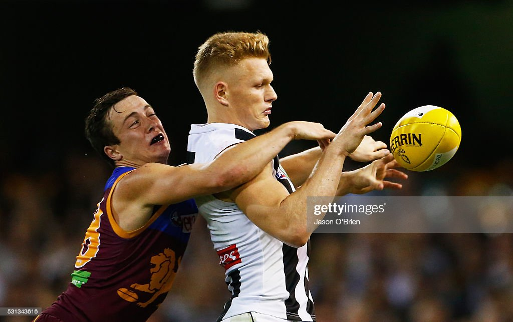 Adam Treloar of the magpies is tackled by Ben Sinclair of the lions during the round eight AFL match between the Brisbane Lions and the Collingwood Magpies at The Gabba on May 14, 2016 in Brisbane, Australia.
