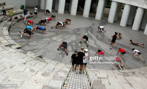 Adam Upton leading a big health class at Hong Kong Park in Central 05JUN13 [JUNE2013 FITNESS WELLBEING FEATURES]