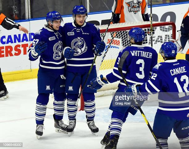Adam Varga celebrates his goal with teammates Filip Reisnecker Richard Whittaker and Nicholas Canade of the Mississauga Steelheads against the Flint...