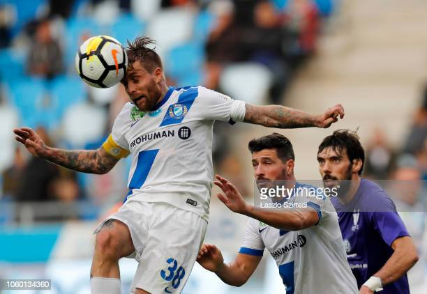 Adam Vass of MTK Budapest heads the ball in front of Bela Balogh of MTK Budapest and Mijusko Bojovic of Ujpest FC during the Hungarian OTP Bank Liga...