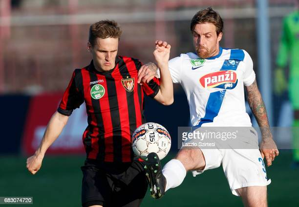 Adam Vass of MTK Budapest wins the ball from Gergo Nagy of Budapest Honved during the Hungarian OTP Bank Liga match between Budapest Honved and MTK...