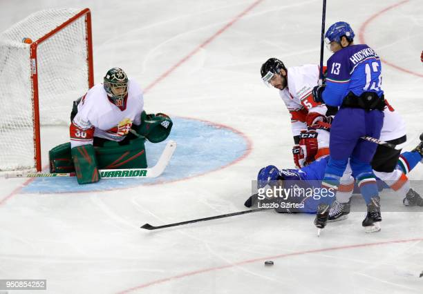 Adam Vay of Hungary Raphael Andergassen of Italy Arnold Varga of Hungary and Peter Hochkofler of Italy in action during the 2018 IIHF Ice Hockey...