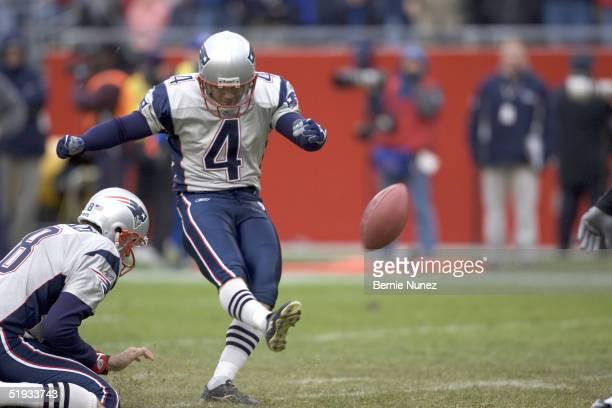 Adam Viantieri of the New England Patriots kicks an extra point as Josh Miller holds against the Cincinnati Bengals at Gillette Stadium on December...