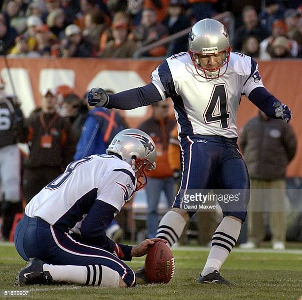 Adam Vinateri of the New England Patriots kicks a field goal as Josh Miller holds during the third qurter against the Cleveland Browns at Cleveland...