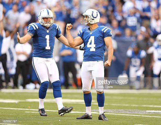 Adam Vinatieri of the Indianapolis Colts and Pat McAfee celebrate after Vinatieri made the game winning 53 yard field goal during the NFL game...