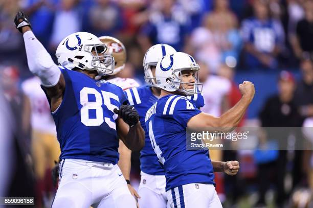 Adam Vinatieri of the Indianapolis Colts celebrates after making a 51 yard field goal in overtime to defeat the San Francisco 49ers 2623 at Lucas Oil...