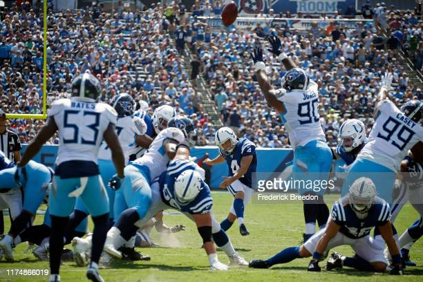 Adam Vinatieri of the Indianapolis Colts kicks an extra point after a touchdown against the Tennessee Titans during the first half at Nissan Stadium...