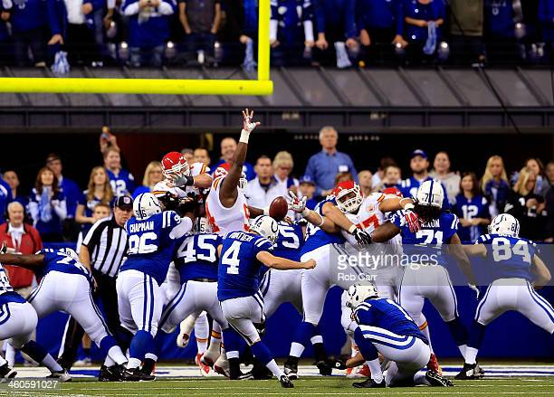 Adam Vinatieri of the Indianapolis Colts kicks an extra point against the Kansas City Chiefs during a Wild Card Playoff game at Lucas Oil Stadium on...
