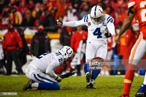 Adam Vinatieri of the Indianapolis Colts misses a second kick of the game on an extra point against the Kansas City Chiefs during the fourth quarter...