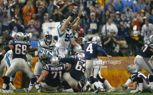 Adam Vinatieri of the New England Patriots 36 yard field goal attempt is blocked by Shane Burton of the Carolina Panthers during the second quarter...