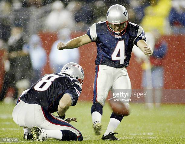 Adam Vinatieri of the New England Patriots kicks a extra point as Josh Miller holds against the Philadelphia Eagles on August 13 2004 at Gillette...