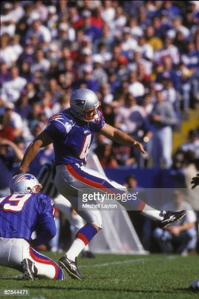 Adam Vinatieri of the New England Patriots kicks a field goal during a NFL football game against the Washington Redskins on October 13 1996 at...